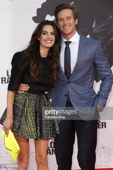 Elizabeth Chambers and Armie Hammer attend the 'Lone Ranger' Berlin Premiere at Sony Centre on July 19 2013 in Berlin Germany