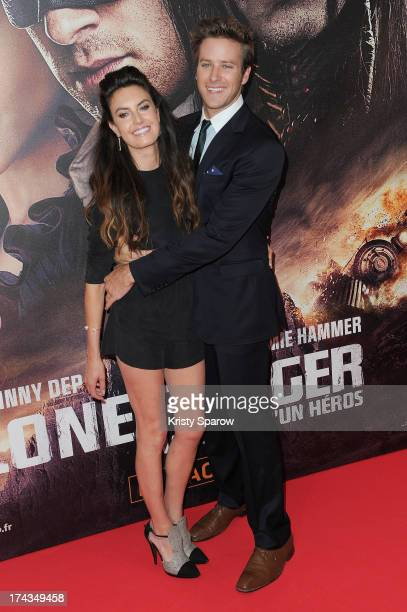 Elizabeth Chambers and Armie Hammer attend the Paris Premiere of 'The Lone Ranger' at Cinema UGC Normandie on July 24 2013 in Paris France