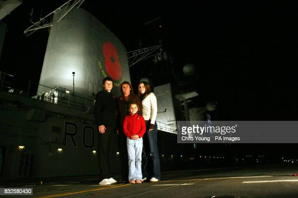 Elizabeth Chapman stands on the flight deck of HMS Illustrious with her daughters Chloe 16 Georgina and her son Ben as the aircraft carrier docks in...