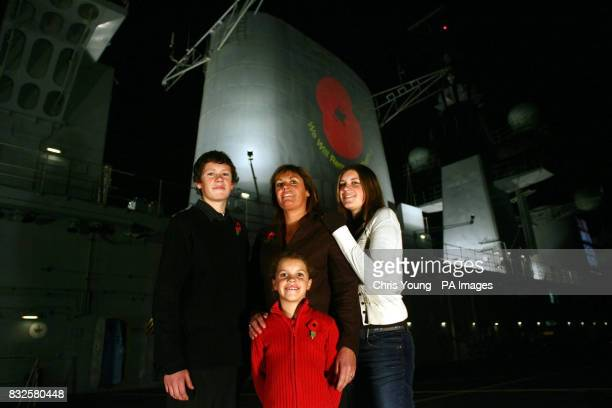 Elizabeth Chapman stands on the flight deck of HMS Illustrious with her daughters Chloe Georgina and her son Ben as the aircraft carrier docks in...