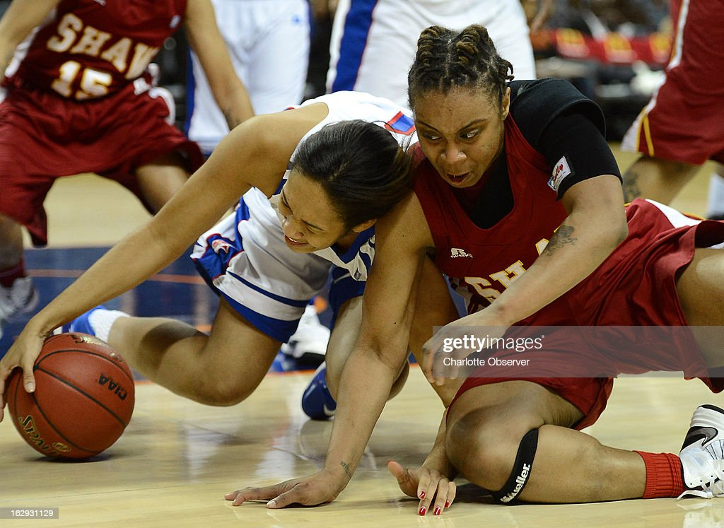 Elizabeth City State's Chelsey Lee fights to gain control of a loose ball with Shaw's Crystal Wilson, right, during the CIAA tournament semifinals on Friday, March 1, 2013, at Time Warner Cable Arena in Charlotte, North Carolina. Shaw advanced, 76-61.