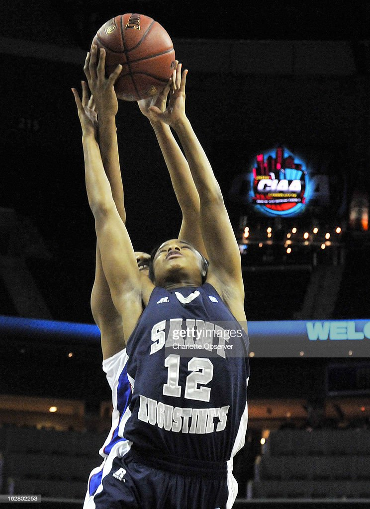 Elizabeth City State's Shawnte Taylor and Saint Augustine's Porscha Walton (12) fight for a rebound in CIAA Tournament action on Wednesday, February 27, 2013, at Time Warner Cable Arena in Charlotte, North Carolina. Elizabeth City State advanced to the semifinals, 74-68.
