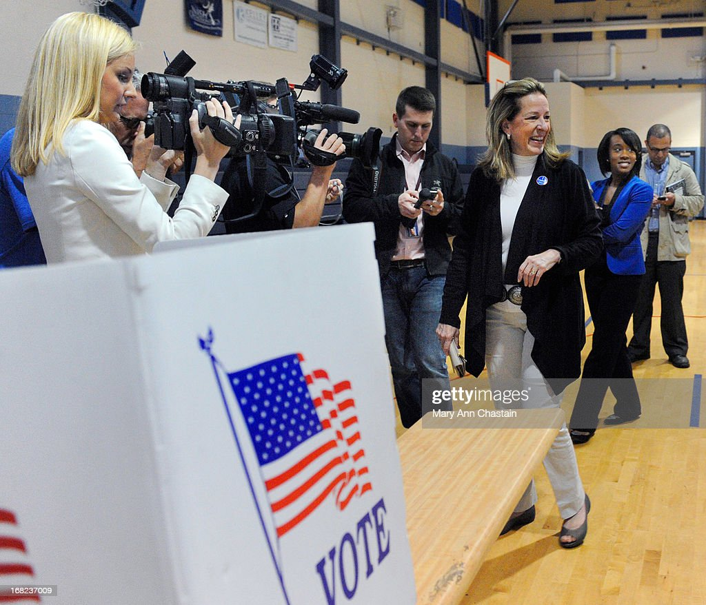 <a gi-track='captionPersonalityLinkClicked' href=/galleries/search?phrase=Elizabeth+Colbert+Busch&family=editorial&specificpeople=10285068 ng-click='$event.stopPropagation()'>Elizabeth Colbert Busch</a> leaves after casting her vote in a special election runoff with former South Carolina Gov. Mark Sanford for a seat in the 1st Congressional District May 7, 2013 in Charleston, South Carolina. Voters are deciding between Sanford, a Republican seeking a political comeback after an extramarital affair and Busch, a Democratic businesswoman and the sister of comedian of Stephen Colbert.