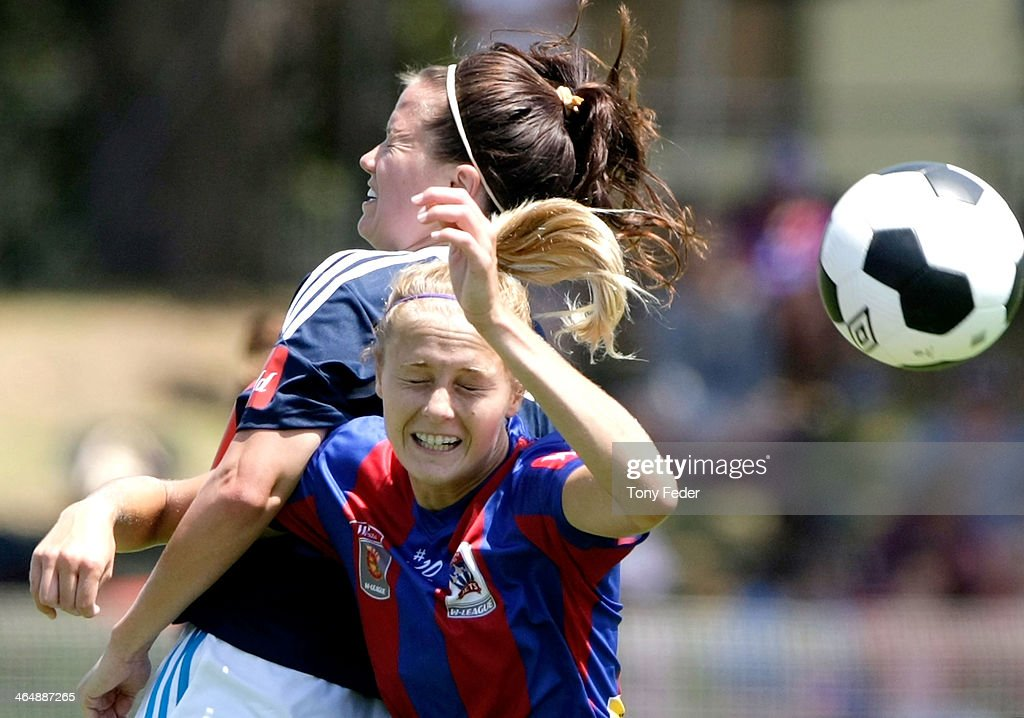 Elizabeth Copus-Brown of the Jets contests a header during the round 10 W-League match between the Newcastle Jets and Melbourne Victory at Adamstown Oval on January 25, 2014 in Newcastle, Australia.