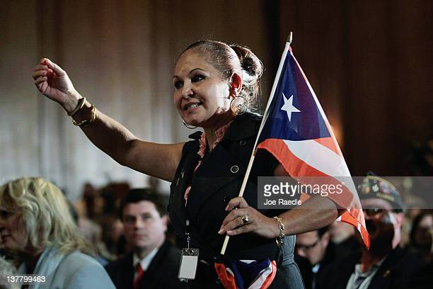Elizabeth CuevasNeunder holds a Puerto Rican flag as she directs a question to Republican presidential candidate and former Speaker of the House Newt...