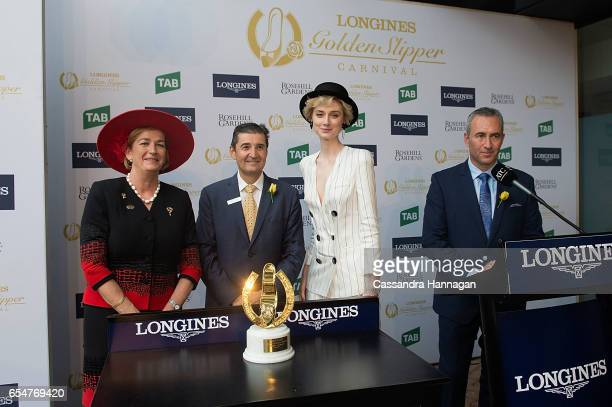 Elizabeth Debicki presents the Golden Slipper trophy during Golden Slipper Day at Rosehill Gardens on March 18 2017 in Sydney Australia