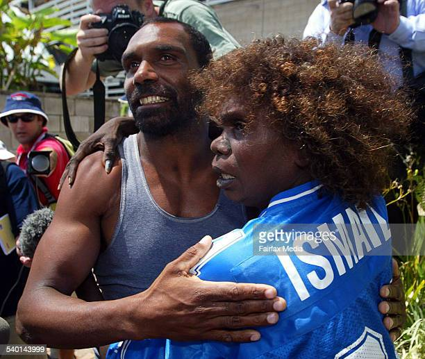 Elizabeth Doomadgee embraces Lex Wotton outside Townsville police station after he was imprisoned for his involvement in the Palm island riots Ms...
