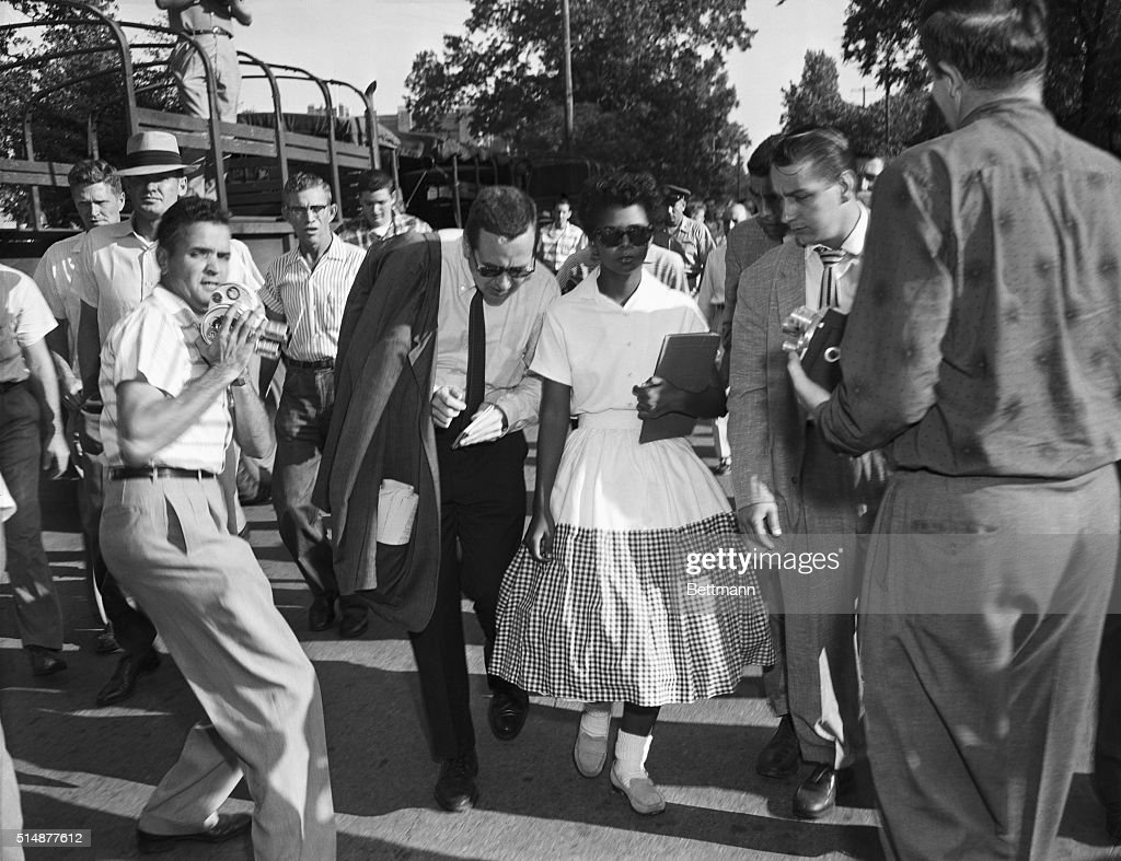 Elizabeth Eckford, one of the Little Rock Nine, is surrounded by journalists after she is prevented from entering Little Rock's Central High School by the Arkansas National Guard.