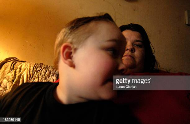 Elizabeth Fisher and her fouryearold son Justin sit on the family couch in their north Toronto apartment Fisher is raising two kids with her...