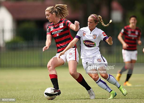 Elizabeth Grey of the Wanderers competes with Nicole Stanton of the Glory during the round 14 WLeague match between the Western Sydney Wanderers and...