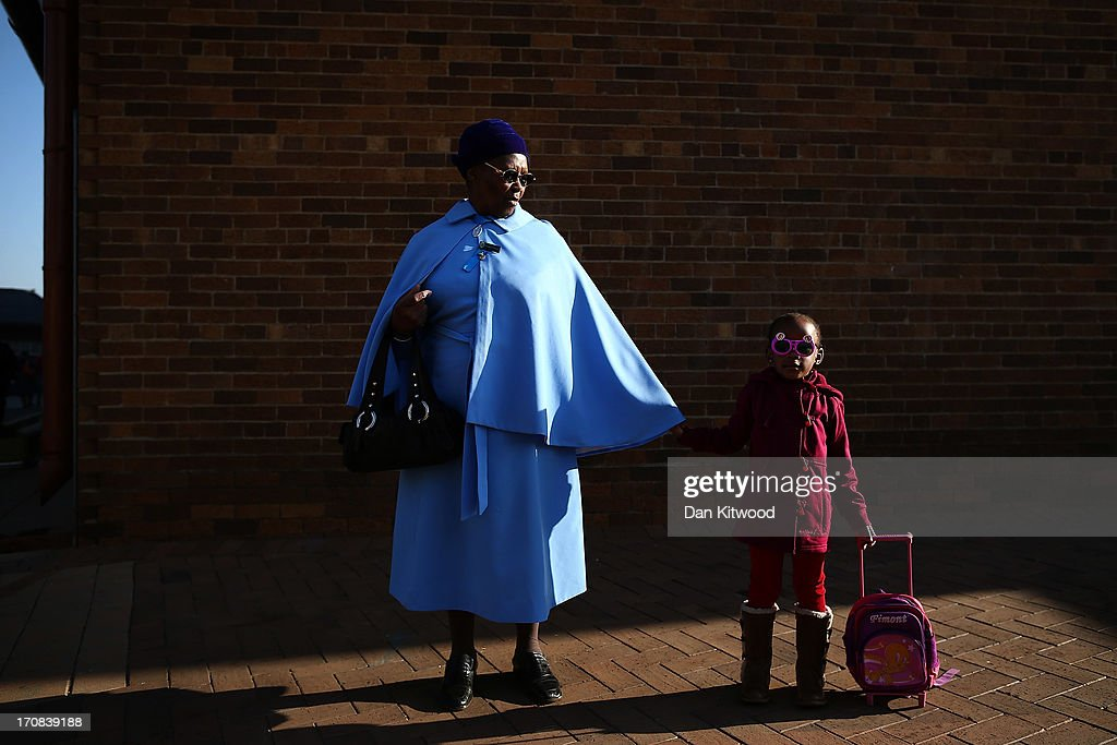 Elizabeth Gwele, 70 and granddaughter Tondo Gwele, 4 pose for a portrait outside the Rogina Mundi church in Soweto on June 16, 2013 in Johannesburg, South Africa. Speaking of Nelson Mandela Mrs Gwele said, 'For us he represents life, without him, we couldn't be what we are now. She (grand daughter) loves him. She calls him dada'. The former South African President and leader of the anti-apartheid movement has spent over a week in hospital after being admitted for a recurring lung infection.