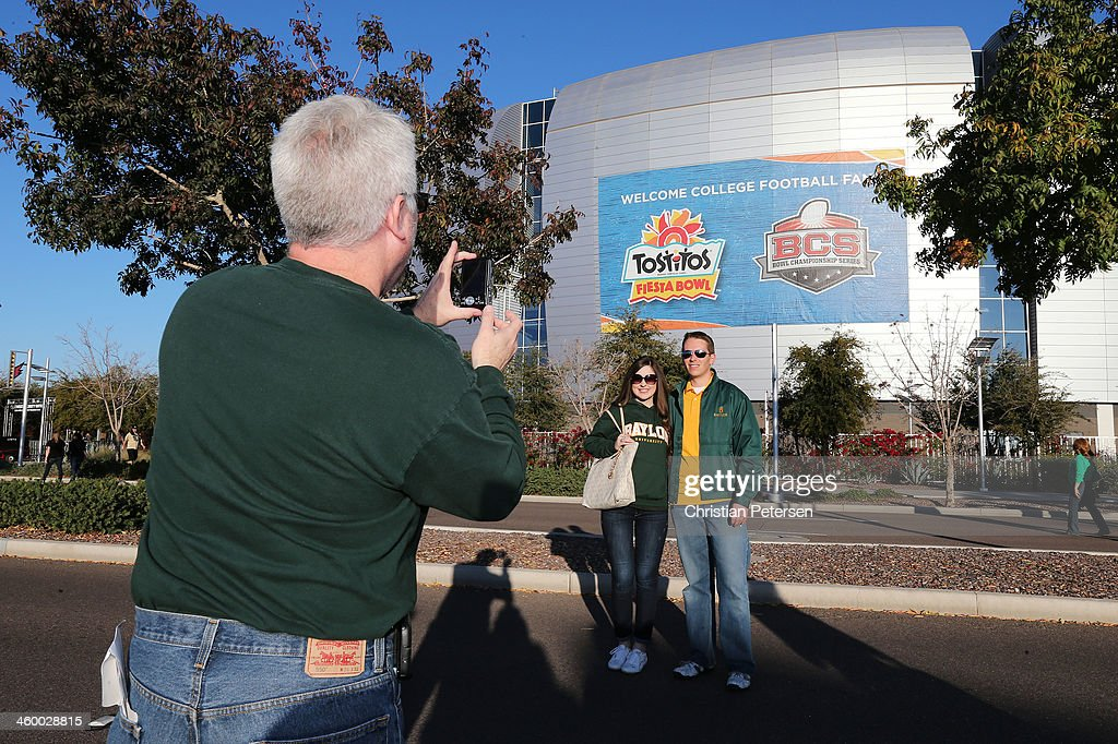 Elizabeth Harris and Robin Haris of Houston Texas pose for a photo prior to the Tostitos Fiesta Bowl between the UCF Knights and the Baylor Bears at...
