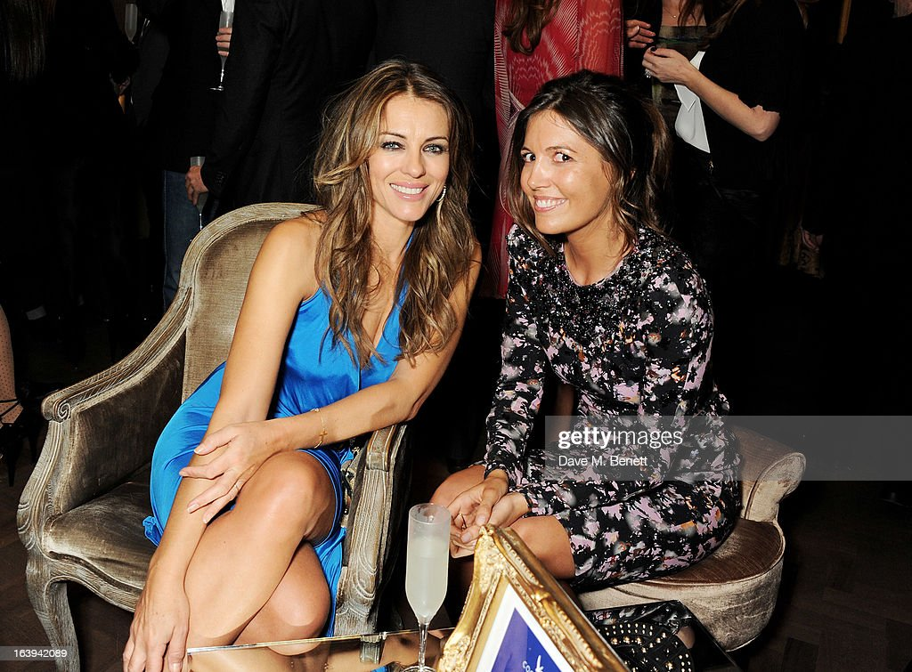 Elizabeth Hurley (L) and Amanda Ferry attend a party celebrating Patrick Cox's 50th Birthday party at Cafe Royal on March 15, 2013 in London, England.
