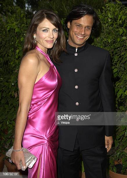 Elizabeth Hurley and Arun Nayer during 2003 Cannes Film Festival Cinema Against Aids 2003 to benefit amfAR sponsored by Miramax Arrivals at Le Moulin...