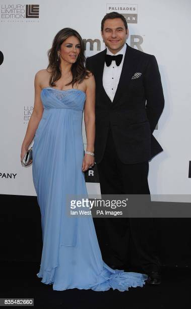 Elizabeth Hurley and David Walliams arrive at the AmfAR charity dinner at the Hotel Du Cap in Antibes France