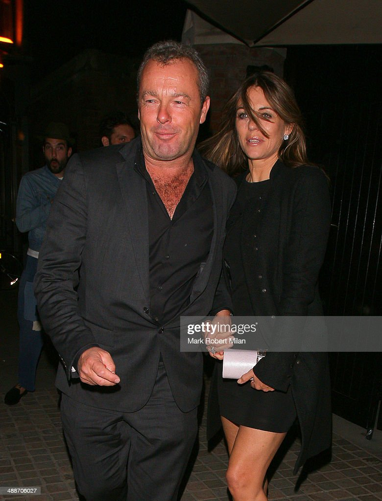 <a gi-track='captionPersonalityLinkClicked' href=/galleries/search?phrase=Elizabeth+Hurley&family=editorial&specificpeople=201731 ng-click='$event.stopPropagation()'>Elizabeth Hurley</a> and David Yarrow leaving the Chiltern Firehouse on May 7, 2014 in London, England.
