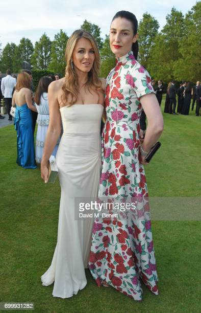 Elizabeth Hurley and Erin O'Connor attend the Woodside Gallery Dinner in benefit of Elton John AIDS Foundation in partnership with BVLGARI at...