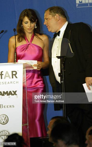 Elizabeth Hurley and Harvey Weinstein during 2003 Cannes Film Festival Cinema Against Aids 2003 to benefit amfAR sponsored by Miramax Auction at...