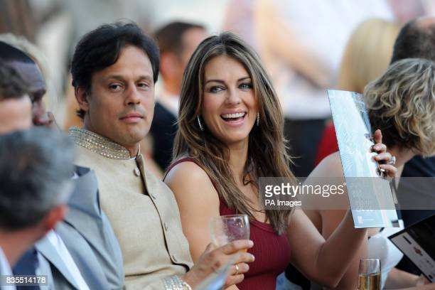 Elizabeth Hurley and her husband Arun Nayar during the Fashion Show at The Amber Lounge Le Meridien Beach Plaza Hotel Monaco