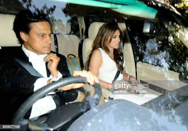 Elizabeth Hurley and husband Arun Nayar arrive for Elton John's White Tie and Tiara Ball at his home in Old Windsor