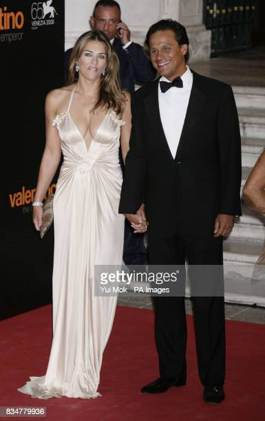 Elizabeth Hurley and husband Arun Nayar attend the premiere of the movie 'Valentino The Last Emperor' held at Teatro La Fenice during the 65th Venice...