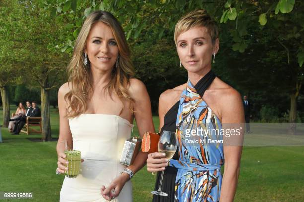 Elizabeth Hurley and Jo Manoukian attend the Woodside Gallery Dinner in benefit of Elton John AIDS Foundation in partnership with BVLGARI at Woodside...
