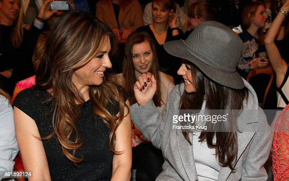 Elizabeth Hurley and Katie Holmes attend the Marc Cain show during the MercedesBenz Fashion Week Berlin Autumn/Winter 2015/16 at Brandenburg Gate on...