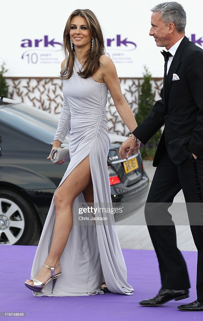 Elizabeth Hurley and Patrick Cox arrive at the ARK 10th Anniversary Gala Dinner at Perk's Field on June 9 2011 in London England