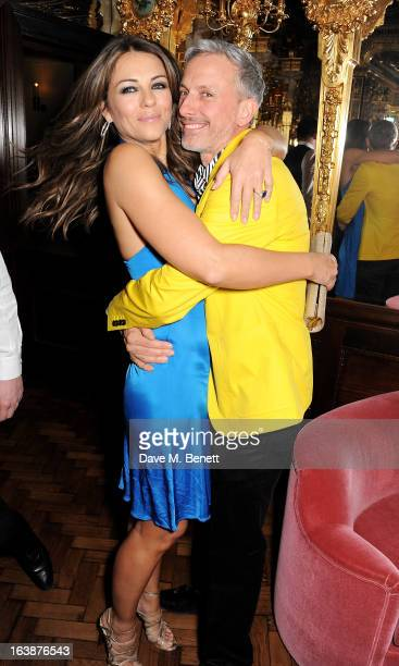 Elizabeth Hurley and Patrick Cox attend a drinks reception celebrating Patrick Cox's 50th Birthday party at Cafe Royal on March 15 2013 in London...