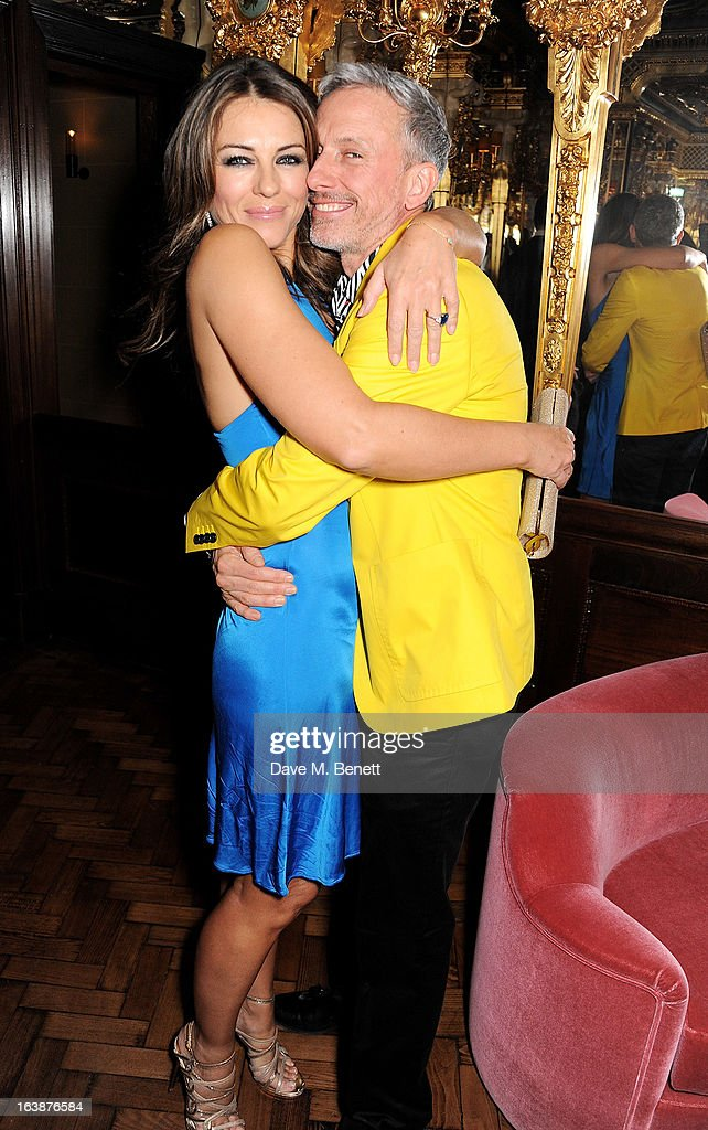 Elizabeth Hurley (L) and Patrick Cox attend a drinks reception celebrating Patrick Cox's 50th Birthday party at Cafe Royal on March 15, 2013 in London, England.