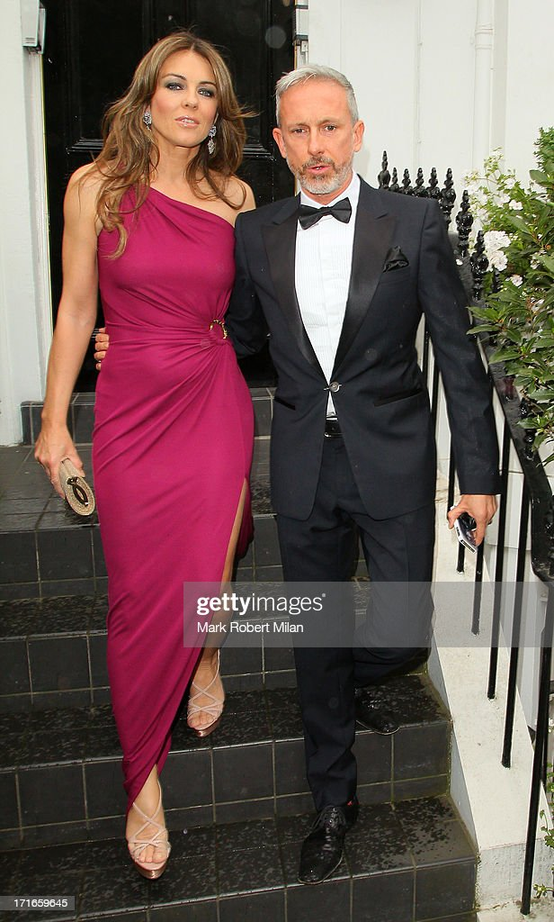 Elizabeth Hurley and Patrick Cox departing for Elton John's White Tie and Tiara Ball on June 27, 2013 in London, England.
