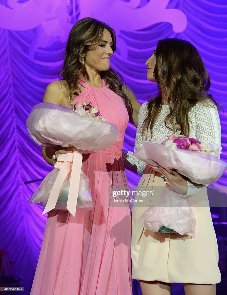 Elizabeth Hurley (L) and Sara Bareilles pose onstage at The Breast Cancer Foundation's 2014 Hot Pink Party at Waldorf Astoria Hotel on April 28, 2014 in New York City.