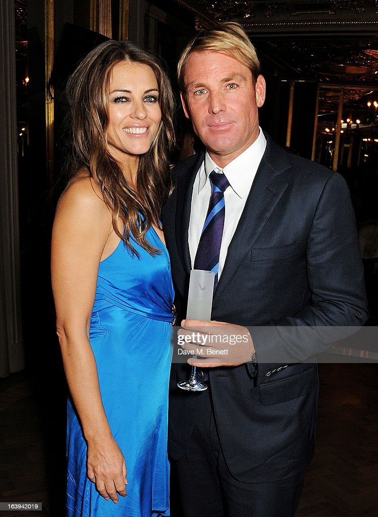 Elizabeth Hurley (L) and Shane Warne attend a party celebrating Patrick Cox's 50th Birthday party at Cafe Royal on March 15, 2013 in London, England.