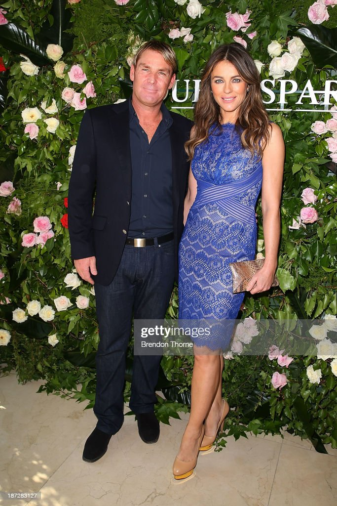 <a gi-track='captionPersonalityLinkClicked' href=/galleries/search?phrase=Elizabeth+Hurley&family=editorial&specificpeople=201731 ng-click='$event.stopPropagation()'>Elizabeth Hurley</a> and <a gi-track='captionPersonalityLinkClicked' href=/galleries/search?phrase=Shane+Warne&family=editorial&specificpeople=167242 ng-click='$event.stopPropagation()'>Shane Warne</a> attend a Queenspark breakfast to celebrate the brand's Summer 2013 collection on November 8, 2013 in Sydney, Australia.