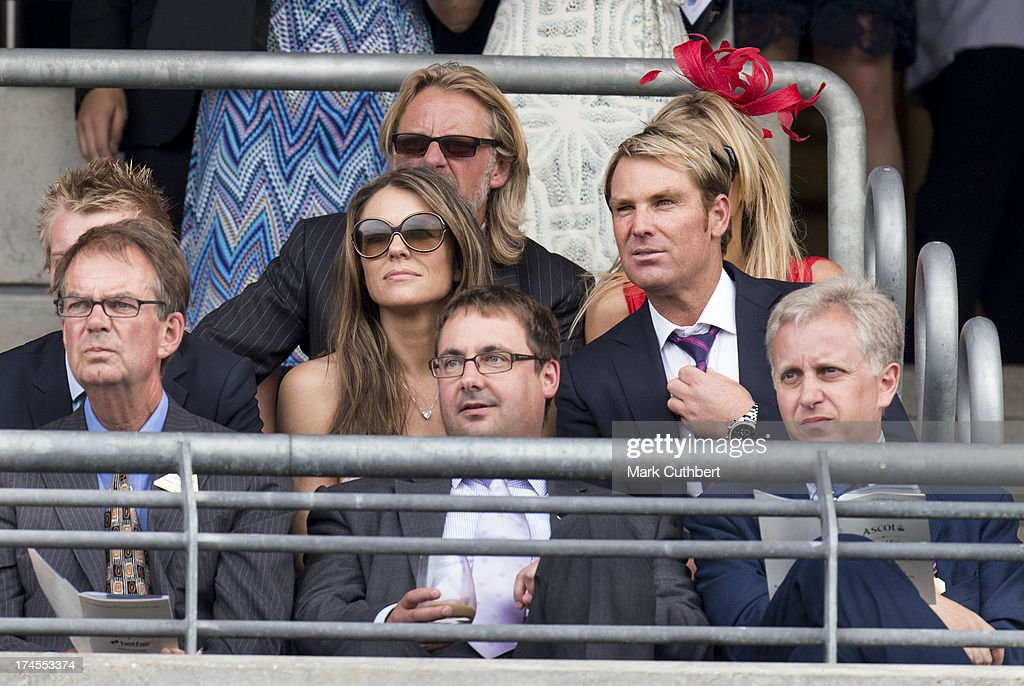 <a gi-track='captionPersonalityLinkClicked' href=/galleries/search?phrase=Elizabeth+Hurley&family=editorial&specificpeople=201731 ng-click='$event.stopPropagation()'>Elizabeth Hurley</a> and <a gi-track='captionPersonalityLinkClicked' href=/galleries/search?phrase=Shane+Warne&family=editorial&specificpeople=167242 ng-click='$event.stopPropagation()'>Shane Warne</a> attend the Betfair weekend featuring The King George VI and Queen Elizabeth Stakes at Ascot Racecourse on July 27, 2013 in Ascot, England.