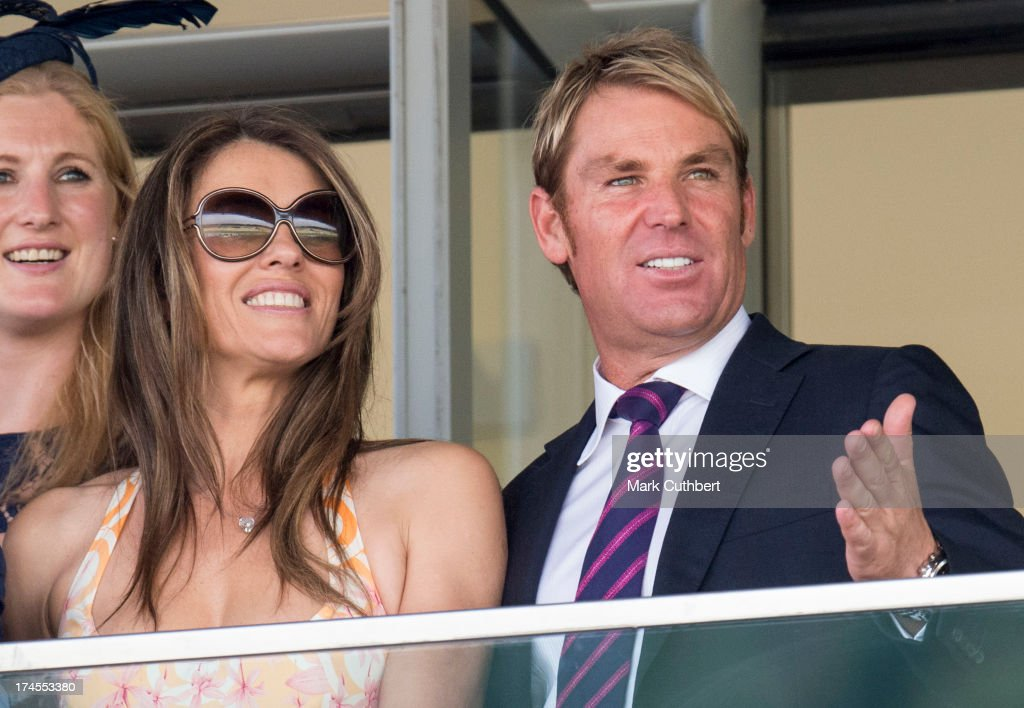 Elizabeth Hurley and Shane Warne attend the Betfair weekend featuring The King George VI and Queen Elizabeth Stakes at Ascot Racecourse on July 27, 2013 in Ascot, England.