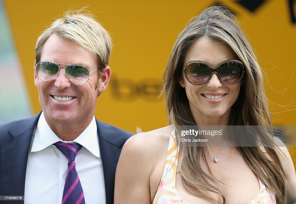 Elizabeth Hurley and Shane Warne attend the Betfair Weekend King George Day and Summer Garden Party at Ascot Racecourse on July 27, 2013 in Ascot, England.