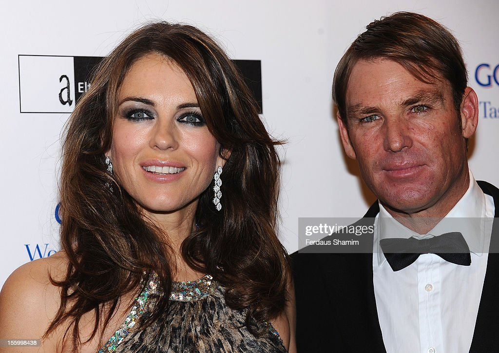 <a gi-track='captionPersonalityLinkClicked' href=/galleries/search?phrase=Elizabeth+Hurley&family=editorial&specificpeople=201731 ng-click='$event.stopPropagation()'>Elizabeth Hurley</a> and <a gi-track='captionPersonalityLinkClicked' href=/galleries/search?phrase=Shane+Warne&family=editorial&specificpeople=167242 ng-click='$event.stopPropagation()'>Shane Warne</a> attend the Grey Goose Winter Ball at Battersea Power station on November 10, 2012 in London, England.