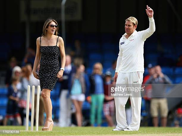Elizabeth Hurley and Shane Warne look on during the Shane Warne's Australia vs Michael Vaughan's England T20 match at Circenster Cricket Club on June...