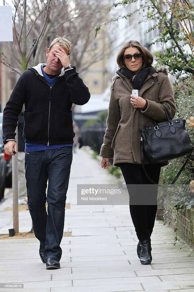 Elizabeth Hurley and Shane Warne seen walking near their Fulham home on March 13, 2013 in London, England.