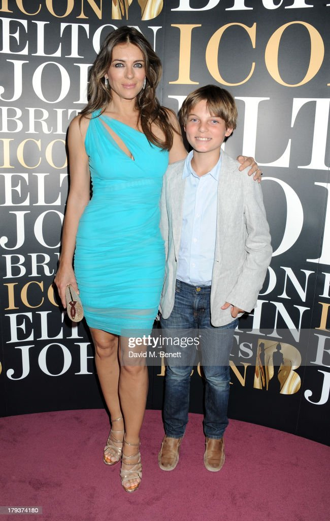 <a gi-track='captionPersonalityLinkClicked' href=/galleries/search?phrase=Elizabeth+Hurley&family=editorial&specificpeople=201731 ng-click='$event.stopPropagation()'>Elizabeth Hurley</a> (L) and son Damian attend as Sir Elton John is awarded the first annual 'BRITS Icon' award at the London Palladium on September 2, 2013 in London, England.