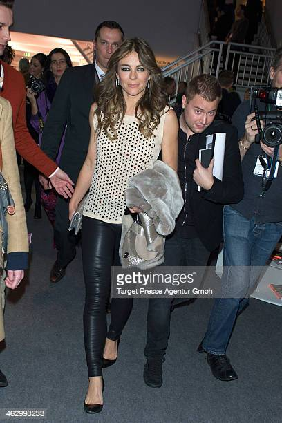 Elizabeth Hurley arrives the Marc Cain show during MercedesBenz Fashion Week Autumn/Winter 2014/15 at Brandenburg Gate on January 16 2014 in Berlin...