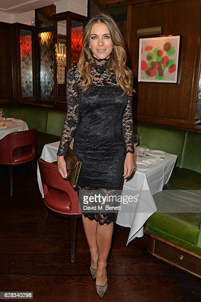 Elizabeth Hurley attends an intimate performance with Kylie Minogue at The Ivy to kick off The Ivy 100 Centenary celebrations on December 7 2016 in...