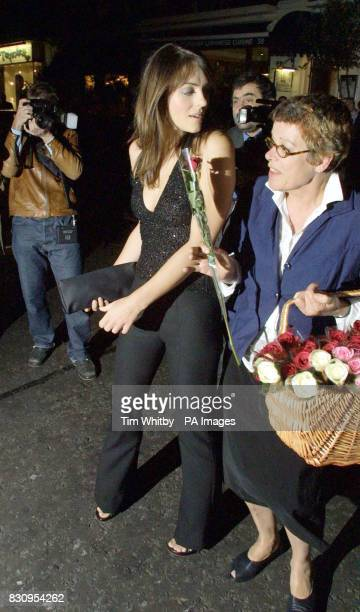 Elizabeth Hurley being hassled by flower seller as she arrives at San Lorenzo in London for a private dinner to celebrate the opening of a new...