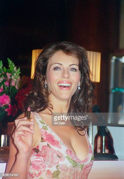Elizabeth Hurley closeup with lipstick in her hand circa 1990 New York