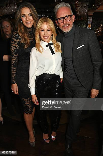 Elizabeth Hurley Kylie Minogue and Patrick Cox attend an intimate performance with Kylie Minogue at The Ivy to kick off The Ivy 100 Centenary...