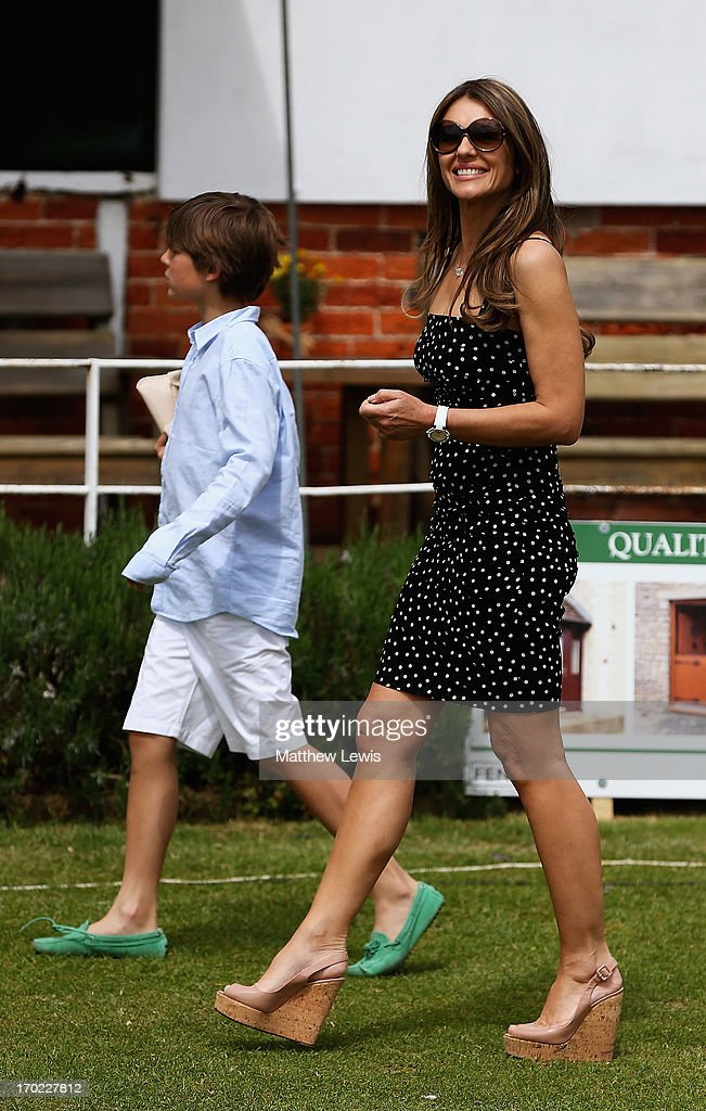Elizabeth Hurley looks on during the Shane Warne's Australia vs Michael Vaughan's England T20 match at Circenster Cricket Club on June 9, 2013 in Cirencester, England.