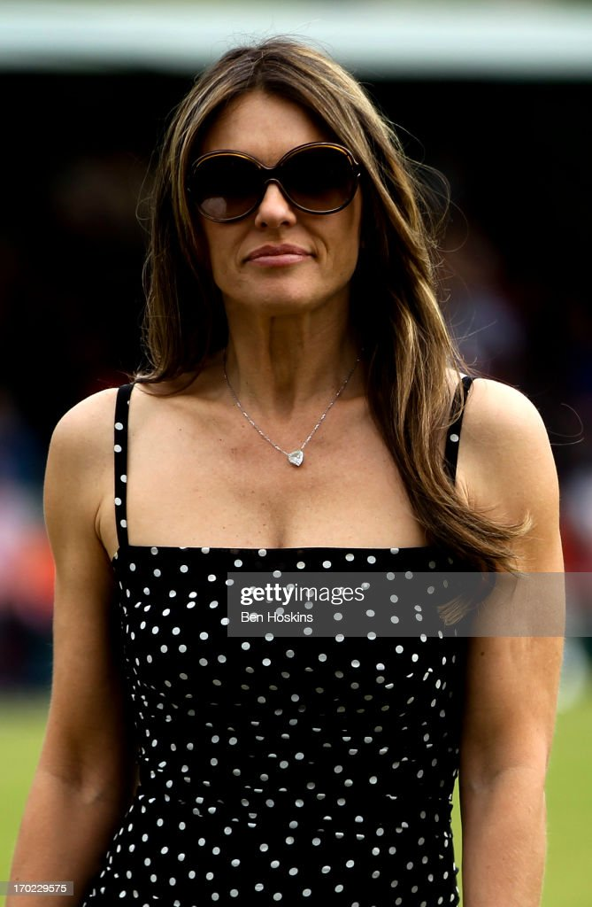 <a gi-track='captionPersonalityLinkClicked' href=/galleries/search?phrase=Elizabeth+Hurley&family=editorial&specificpeople=201731 ng-click='$event.stopPropagation()'>Elizabeth Hurley</a> looks on prior to Shane Warne's Australia vs Michael Vaughan's England T20 match at Cirencester Cricket Club on June 09, 2013 in Cirencester, England.