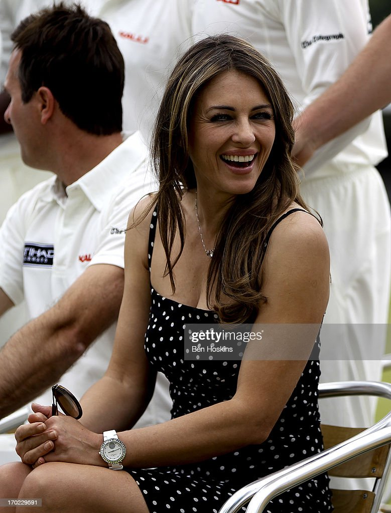 Elizabeth Hurley looks on prior to Shane Warne's Australia vs Michael Vaughan's England T20 match at Cirencester Cricket Club on June 09, 2013 in Cirencester, England.