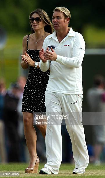 Elizabeth Hurley looks on with Shane Warne during Shane Warne's Australia vs Michael Vaughan's England T20 match at Cirencester Cricket Club on June...
